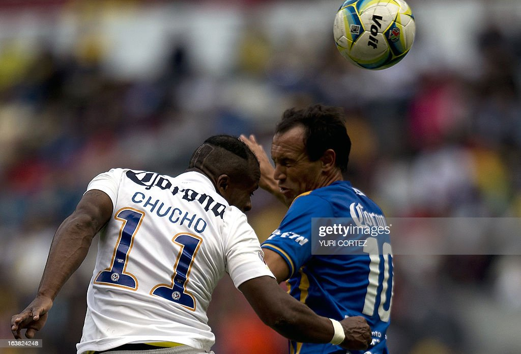 America's forward Christian Benitez (L) jumps to head the ball with San Luis's Mauro Matos (R) during their Clausura 2013 Mexican league football match at the Azteca stadium in Mexico City, on March 16, 2013. AFP PHOTO/ YURI CORTEZ