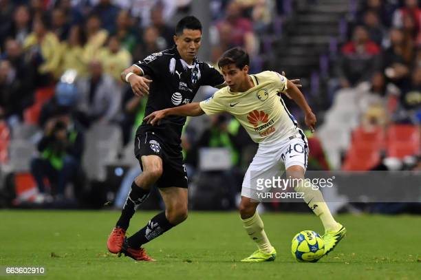 America's forward Diego Lainez vies for the ball with Monterrey's midfielder Jesus Molina during their Mexican Clausura 2017 Tournament football...