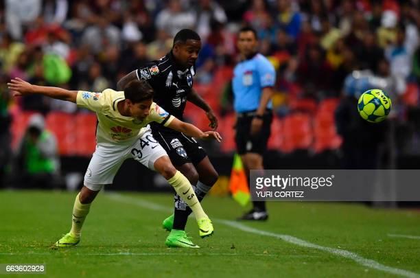 America's forward Diego Lainez vies for the ball with Monterrey's forward Dorlan Pabon during their Mexican Clausura 2017 Tournament football match...
