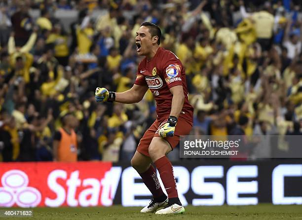 America's goalkeeper Moises Munoz celebrates a goal against Tigres during the Mexican Apertura tournament second leg final football match at the...