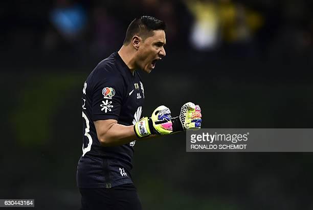 America´s goalkeeper Moises Munoz celebrates a goal against Tigres during their Mexican Apertura 2016 tournament final first leg football match at...