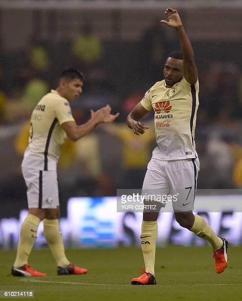 America's midfielder William Da Silva celebrates after scoring the second goal against Pumas during their Mexican Apertura 2016 Tournament football...