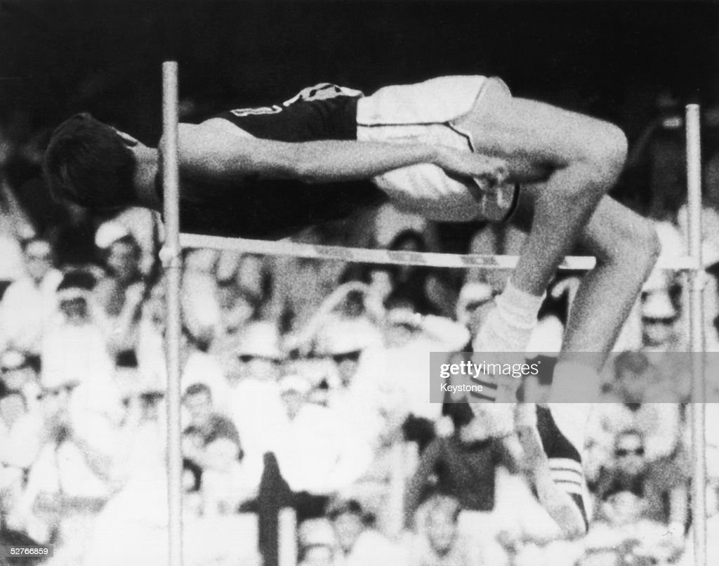 America's Richard Fosbury wins the gold medal in the high jump at the Mexico City Olympics, reaching a height of 7 feet 4 1/4 inches, 23rd October 1968. His revolutionary style of jumping backwards, known as the 'Fosbury Flop', soon became the standard technique.