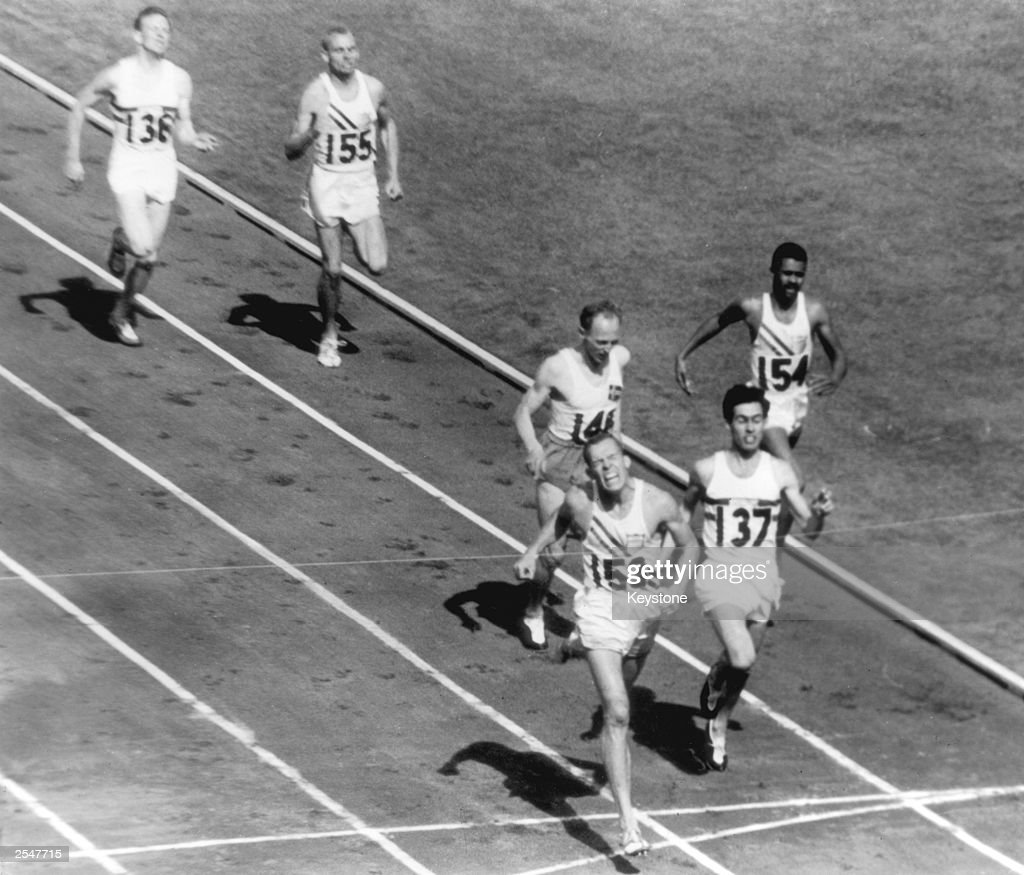 America's Tom Courtney winning the 800 metres final at the Melbourne Olympics, 26th November 1956. British athlete Derek Johnson (No. 53) finishes second and Auden Boysen of Norway (No. 148) takes third place.