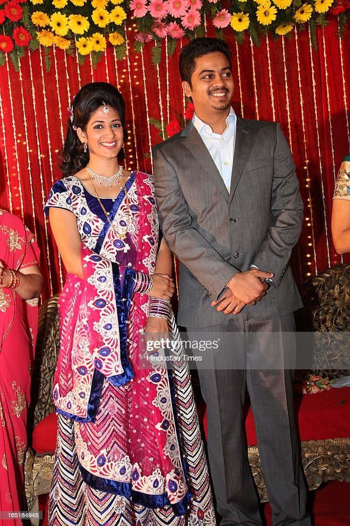 Ameya Yeravdekar and Swati Thorat, grandson of educationist Dr SB Mujumdar pose for picture at their wedding reception at Delhi Gymkhana on March 22, 2013 in New Delhi, India.