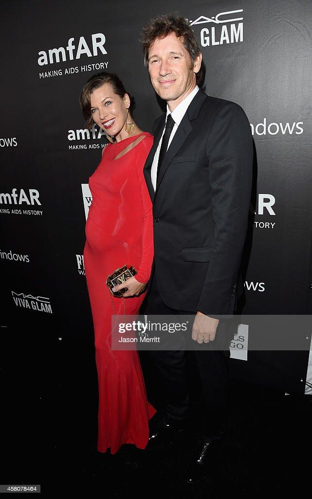 amfAR Ambassador Milla Jovovich and director/writer Paul WS Anderson attend amfAR LA Inspiration Gala honoring Tom Ford at Milk Studios on October 29...