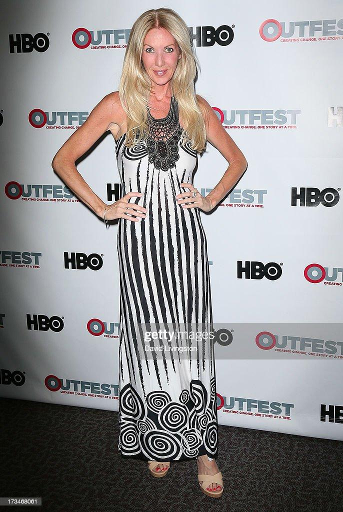 amfAR board member Regan Hofmann attends the 2013 Outfest Film Festival's amfAR panel at the DGA Theater on July 14, 2013 in Los Angeles, California.