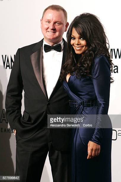 Amfar CEO Kevin Robert Frost and US singer Janet Jackson on the AmfAR Milano 2009 red carpet during the inaugural Milan Fashion Week event at La...
