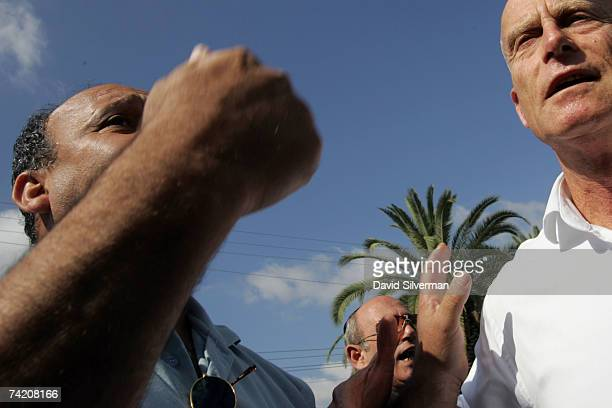 Ami Ayalon a former Israeli admiral and head of the Shin Bet Israel's internal security service is challenged by angry residents as he visits May 21...