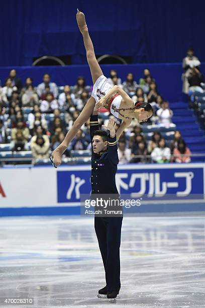 Ami Koga and Francis Boudreau Audet of Japan compete in the Pairs short program during the day two of the ISU World Team Trophy at Yoyogi National...
