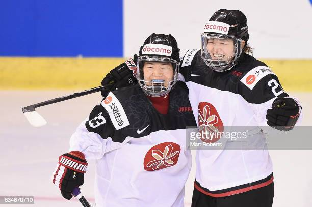 Ami Nakamura of Japan celebrates scoring a goal with team mate Hanae Kubo during the Women's Ice Hockey Olympic Qualification Final game between...