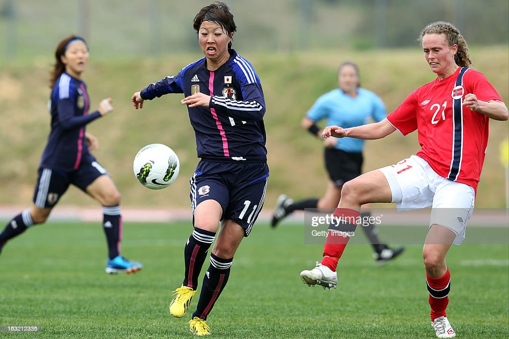 Ami Otaki FW of Japan challenges Solfrid Andersen Dahle DF of Norway during the Algarve Cup match between Japan and Norway at the Complexo Desportivo Belavista on March 6, 2013 in Parchal, Portugal.