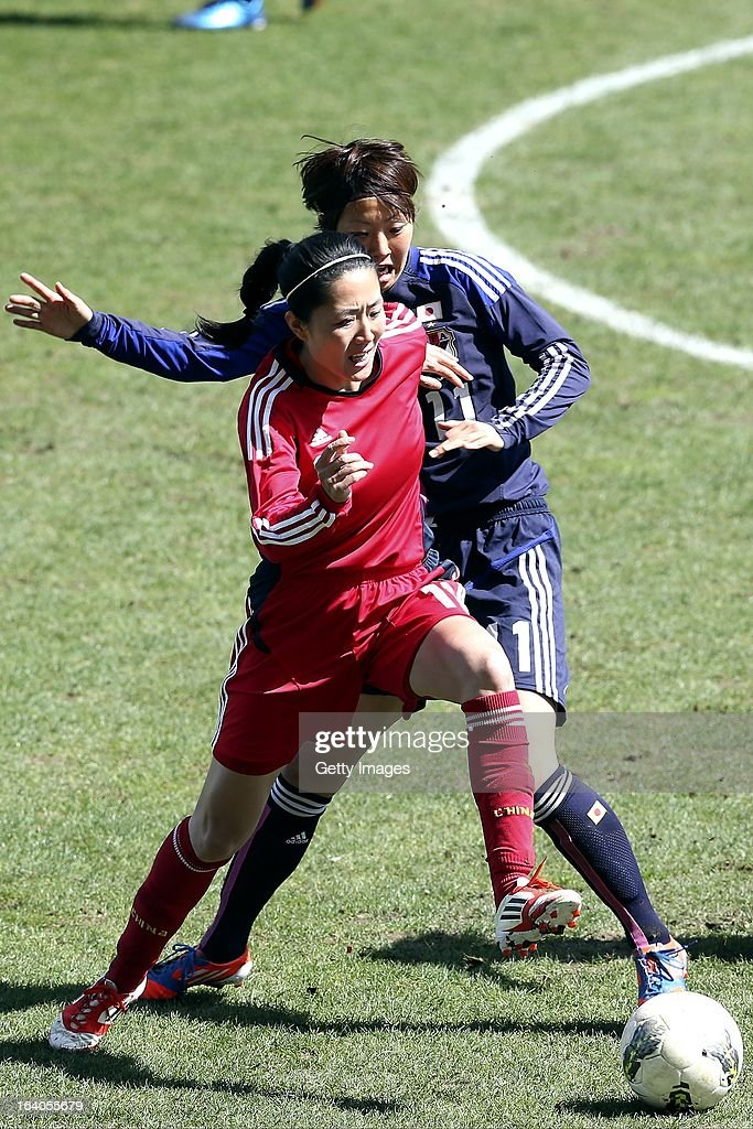 Ami Otaki of Japan challenges Pu Wei of China during the Algarve Cup 2013 fifth place match at the Estadio Algarve on March 13, 2013 in Faro, Portugal.