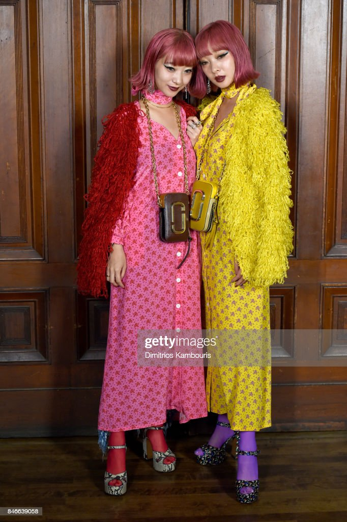 Ami Suzuki and Aya Suzuki attend Marc Jacobs SS18 fashion show during New York Fashion Week at Park Avenue Armory on September 13, 2017 in New York City.