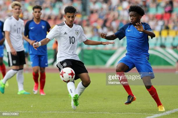 Amid Khan Agha of Germany battles for the ball with Nlandu Noha Ndomabasi of France during the U16 international friendly match between Germany and...