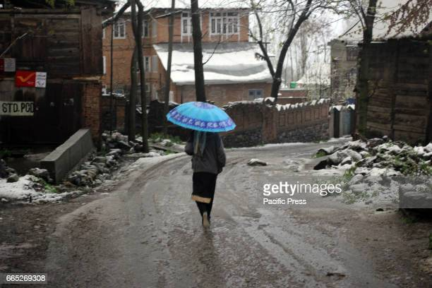 Amid snow accumulated on the roads Kashmiri Muslim girl walking in the interiors of Tral area of South Kashmirs Pulwama district in Indian Controlled...