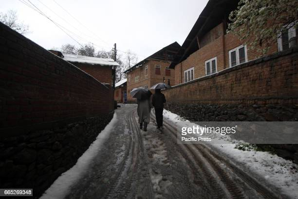 Amid snow accumulated on the roads Kashmiri Muslim men walking in the interiors of Tral area of South Kashmirs Pulwama district in Indian Controlled...
