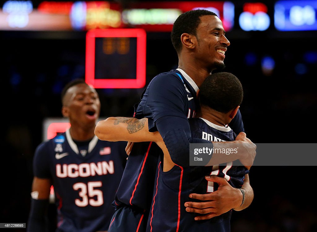 Amida Brimah DeAndre Daniels and Ryan Boatright of the Connecticut Huskies celebrate after defeating the Iowa State Cyclones during the regional...