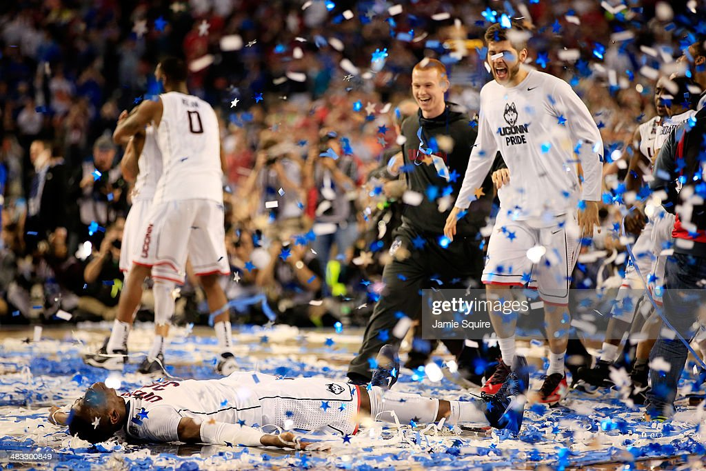 Amida Brimah of the Connecticut Huskies celebrates after defeating the Kentucky Wildcats 6054 in the NCAA Men's Final Four Championship at ATT...