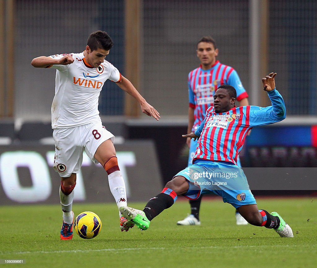 Amidu Salifu (R) of Catania competes for the ball with Eric Lamela of Roma during the Serie A match between Calcio Catania and AS Roma at Stadio Angelo Massimino on January 13, 2013 in Catania, Italy.