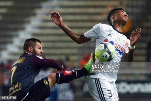 Amiens' Bongani Zungu vies with Dijon's Frederic Sammaritano during the French L1 football match between Amiens and Dijon on November 28 at the...