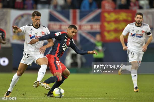 Amien's Brazilian defender Danilo Fernando Avelar vies for the ball with Caen's French forward Ronny Rodelin during the French L1 football match...
