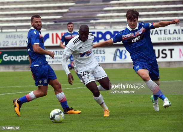 Amiens' defender Mathieu Fontaine vies with Stoke City's Philipp Wollscheid during a friendly football match between Amiens and Stoke City on July 22...