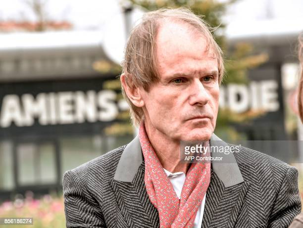 Amiens FC President Bernard Joannin speaks to media in front of the University Hospital of Amiens northern eastern France on October 1 the day after...