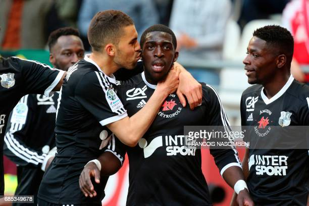 Amiens' forward Aboubakar Famara celebrates with teammates after scoring a goal during the French Ligue 2 Football match Reims versus Amiens on May...
