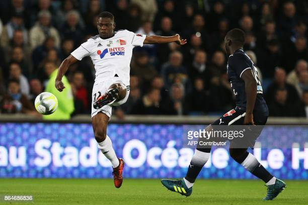 Amiens' French defender Bakaye Dibassy vies for the ball with Bordeaux's French forward Alexandre Mendy during the French L1 football match between...