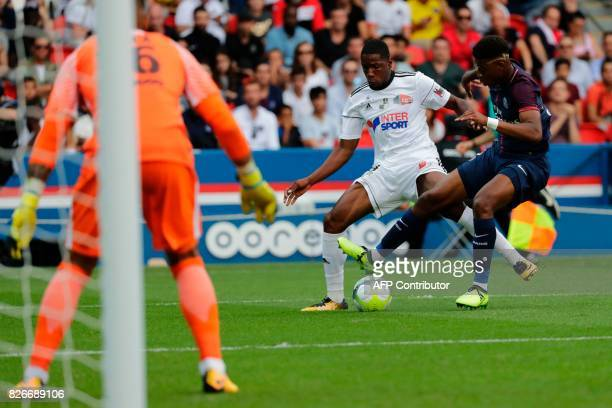 Amiens' French forward Brighton Labeau vies with Paris SaintGermain's French defender Presnel Kimpembe during the French L1 football match between...