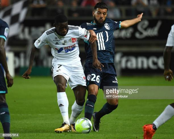 Amiens' French forward Harrison Manzala fights for the ball against LOSC's French midfielder Fares Bahlouli during the French L1 football match...