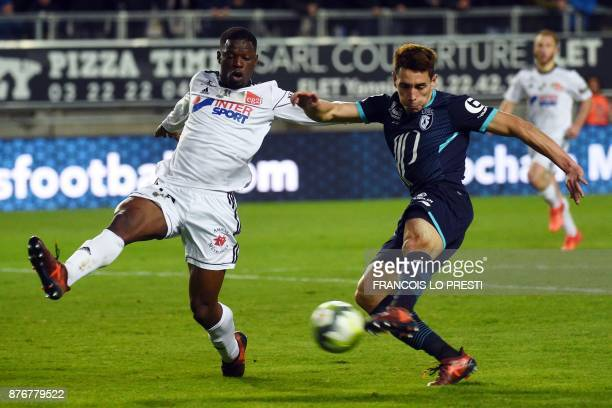 Amiens' French midfielder Tanguy Ndombele vies with Lille's Argentinian forward Ezequiel Ponce during the French L1 football match between Amiens and...