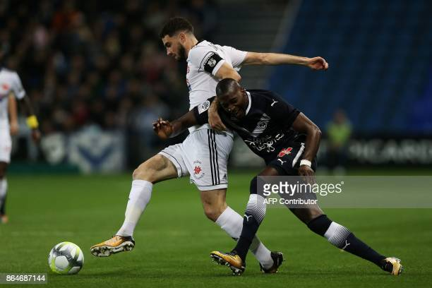 Amiens' French midfielder Thomas Monconduit vies for the ball with Bordeaux's Senegalese midfielder Younousse Sankhare during the French L1 football...
