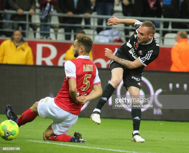 Amiens' midfielder Emmanuel Bourgaud shoots the ball of victory during the Ligue 2 Football match ReimsAmiens on May 19 2017 at the Auguste Delaune...