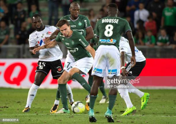 Amien's Senegalese forward Konate Moussa vies with SaintEtienne's Norwegian midfielder Ole Kristian Selnaes during the French L1 football match...