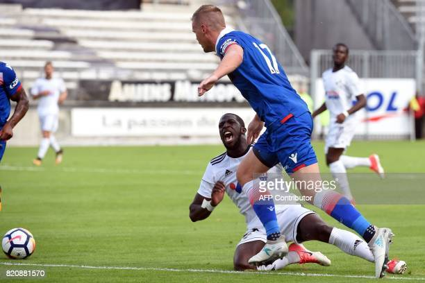 Amiens's Guinean middlefielder Aboubacar Camara vies with Stoke City's British defender Ryan Shawcross during a football friendly match between...