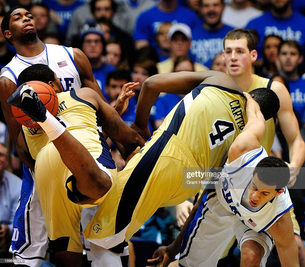 Amile Jefferson #21 and Seth Curry #30 of the Duke Blue Devils tangle with Marcus Georges-Hunt #3 and Robert Carter Jr. #4 of the Georgia Tech Yellow Jackets for a rebound during play at Cameron Indoor Stadium on January 17, 2013 in Durham, North Carolina. Duke won 73-57.