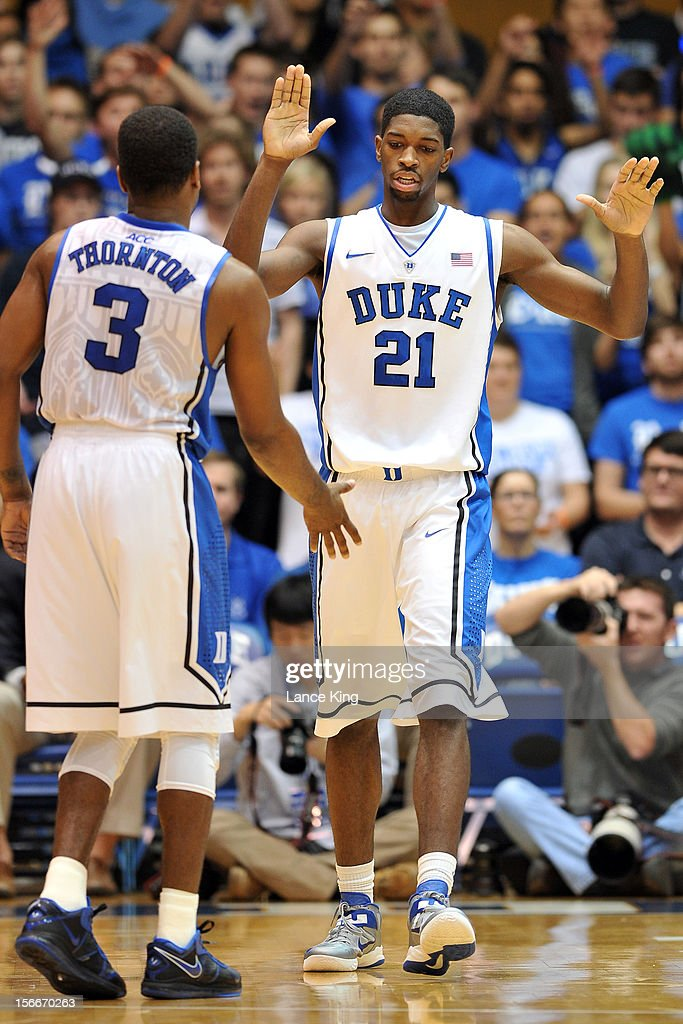 Amile Jefferson #21 and Tyler Thornton #3 of the Duke Blue Devils react following a play against the Florida Gulf Coast Eagles at Cameron Indoor Stadium on November 18, 2012 in Durham, North Carolina.