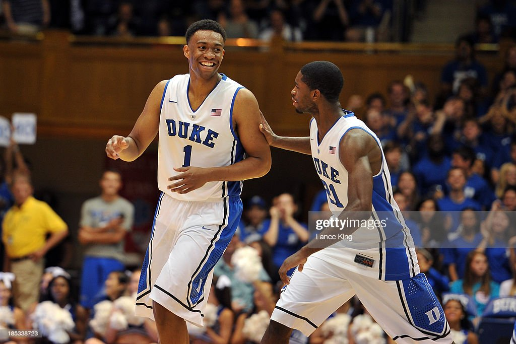 Amile Jefferson #21 celebrates with <a gi-track='captionPersonalityLinkClicked' href=/galleries/search?phrase=Jabari+Parker&family=editorial&specificpeople=9330340 ng-click='$event.stopPropagation()'>Jabari Parker</a> #1 of the Duke Blue Devils following a dunk by Parker during Countdown to Craziness at Cameron Indoor Stadium on October 18, 2013 in Durham, North Carolina.