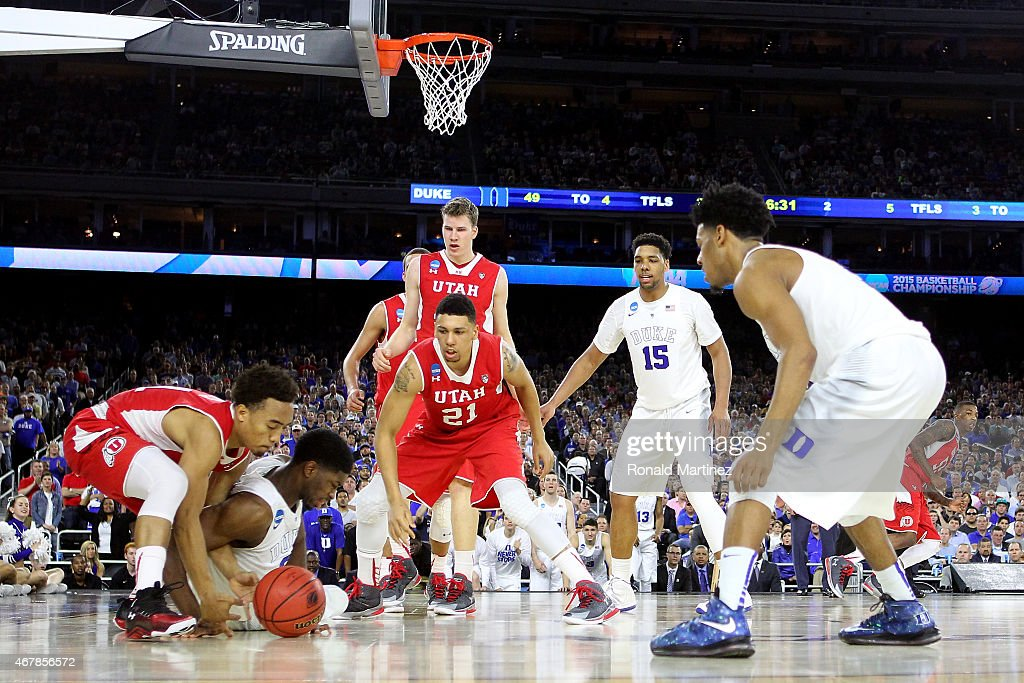 <a gi-track='captionPersonalityLinkClicked' href=/galleries/search?phrase=Amile+Jefferson&family=editorial&specificpeople=7887115 ng-click='$event.stopPropagation()'>Amile Jefferson</a> #21 of the Duke Blue Devils and <a gi-track='captionPersonalityLinkClicked' href=/galleries/search?phrase=Brandon+Taylor+-+Basketball+Guard&family=editorial&specificpeople=15337236 ng-click='$event.stopPropagation()'>Brandon Taylor</a> #11 of the Utah Utes battle for a loose ball during a South Regional Semifinal game of the 2015 NCAA Men's Basketball Tournament at NRG Stadium on March 27, 2015 in Houston, Texas.