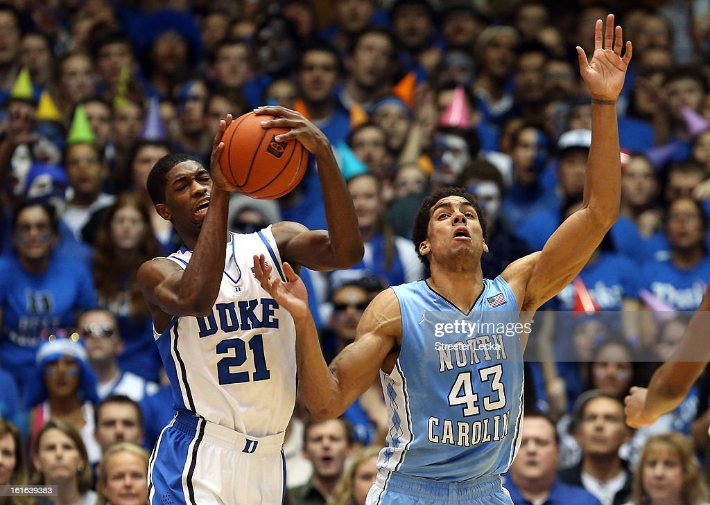 Amile Jefferson #21 of the Duke Blue Devils and James Michael McAdoo #43 of the North Carolina Tar Heels battle for the ball during their game at Cameron Indoor Stadium on February 13, 2013 in Durham, North Carolina.