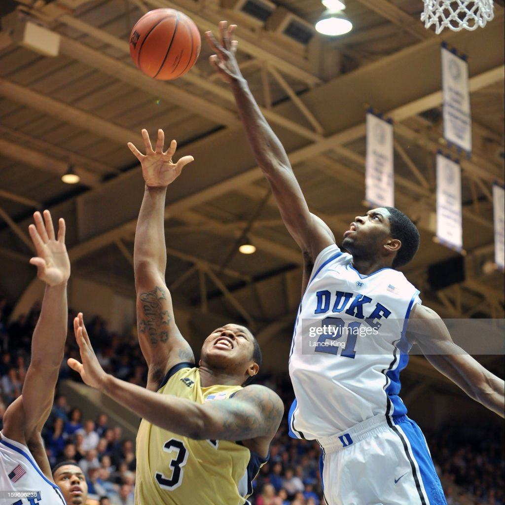Amile Jefferson #21 of the Duke Blue Devils blocks a shot by Marcus Georges-Hunt #3 of the Georgia Tech Yellow Jackets at Cameron Indoor Stadium on January 17, 2013 in Durham, North Carolina. Duke defeated Georgia Tech 73-57.