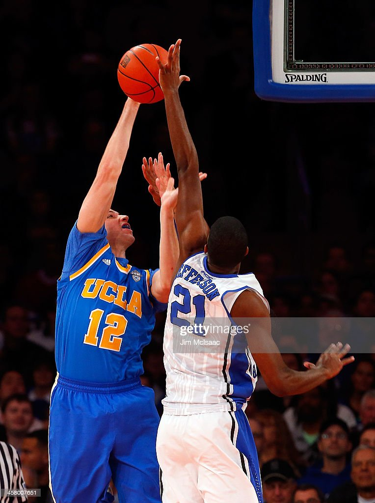 Amile Jefferson #21 of the Duke Blue Devils blocks a shot in the first half against David Wear #12 of the UCLA Bruins during the CARQUEST Auto Parts Classic on December 19, 2013 at Madison Square Garden in New York City.