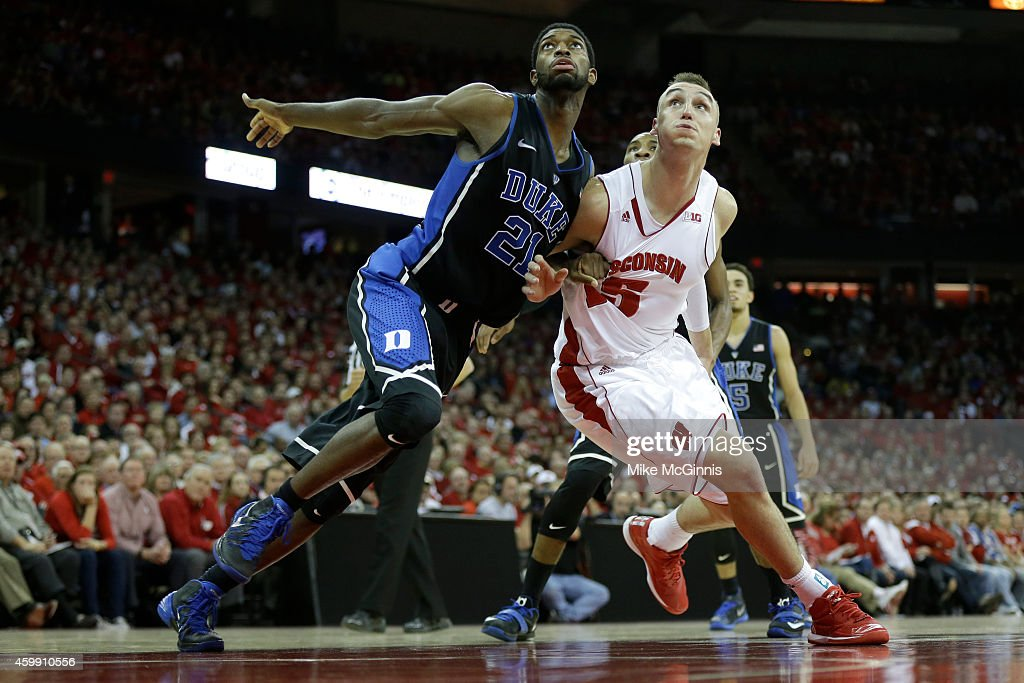 <a gi-track='captionPersonalityLinkClicked' href=/galleries/search?phrase=Amile+Jefferson&family=editorial&specificpeople=7887115 ng-click='$event.stopPropagation()'>Amile Jefferson</a> #21 of the Duke Blue Devils boxes out <a gi-track='captionPersonalityLinkClicked' href=/galleries/search?phrase=Sam+Dekker&family=editorial&specificpeople=7887140 ng-click='$event.stopPropagation()'>Sam Dekker</a> #15 of the Wisconsin Badgers for the rebound during the second half at Kohl Center on December 03, 2014 in Madison, Wisconsin.