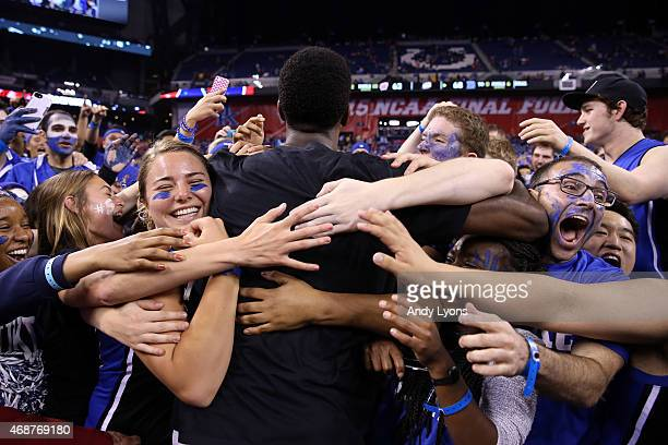 Amile Jefferson of the Duke Blue Devils celebrates with fans after defeating the Wisconsin Badgers during the NCAA Men's Final Four National...