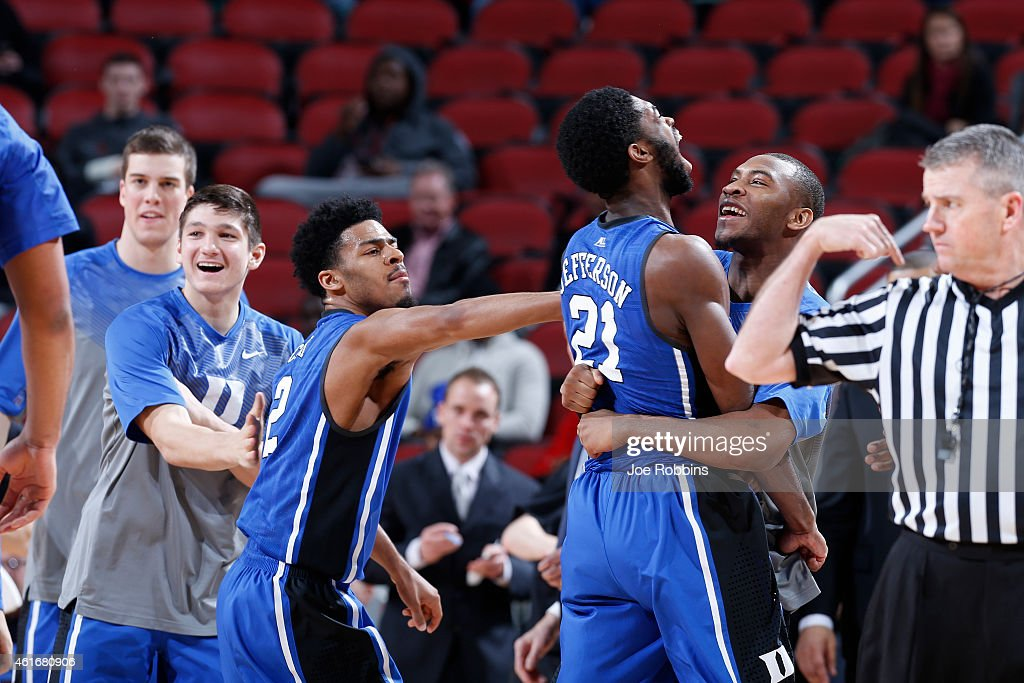 <a gi-track='captionPersonalityLinkClicked' href=/galleries/search?phrase=Amile+Jefferson&family=editorial&specificpeople=7887115 ng-click='$event.stopPropagation()'>Amile Jefferson</a> #21 of the Duke Blue Devils celebrates with teammates <a gi-track='captionPersonalityLinkClicked' href=/galleries/search?phrase=Quinn+Cook&family=editorial&specificpeople=6753591 ng-click='$event.stopPropagation()'>Quinn Cook</a> #2 and <a gi-track='captionPersonalityLinkClicked' href=/galleries/search?phrase=Rasheed+Sulaimon&family=editorial&specificpeople=7887134 ng-click='$event.stopPropagation()'>Rasheed Sulaimon</a> #14 after making a basket against the Louisville during the game at KFC Yum! Center on January 17, 2015 in Louisville, Kentucky. Duke defeated Louisville 63-52.