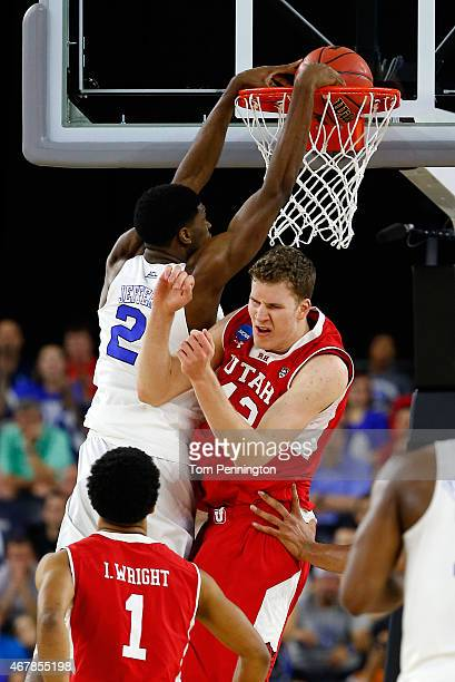Amile Jefferson of the Duke Blue Devils dunks over Jakob Poeltl of the Utah Utes during a South Regional Semifinal game of the 2015 NCAA Men's...