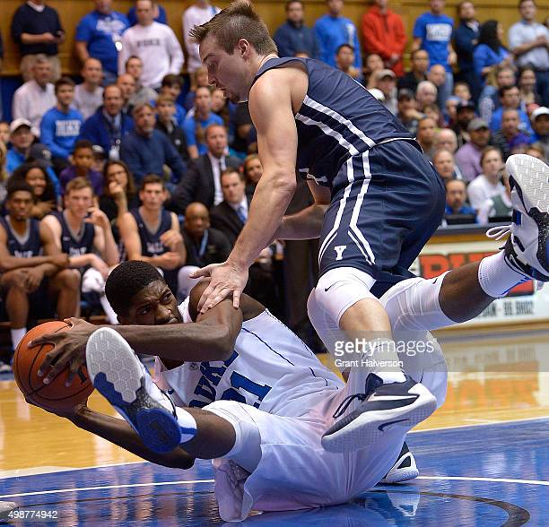 Amile Jefferson of the Duke Blue Devils goes to the floor as he battles Jack Montague of the Yale Bulldogs for a loose ball during their game at...