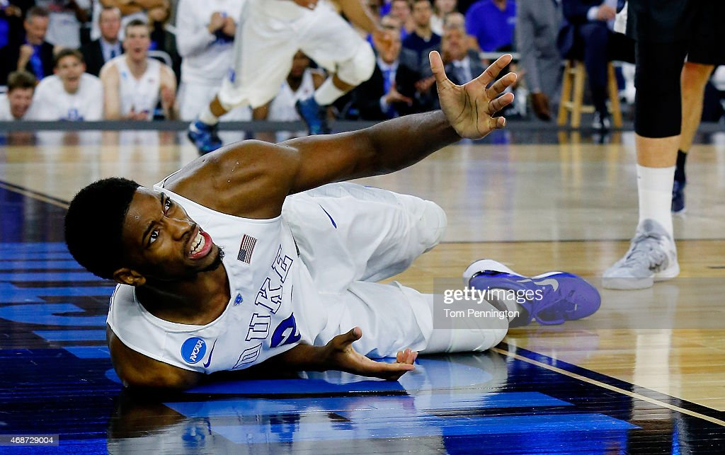 <a gi-track='captionPersonalityLinkClicked' href=/galleries/search?phrase=Amile+Jefferson&family=editorial&specificpeople=7887115 ng-click='$event.stopPropagation()'>Amile Jefferson</a> #21 of the Duke Blue Devils reacts after falling against the Gonzaga Bulldogs during the South Regional Final of the 2015 NCAA Men's Basketball Tournament at NRG Stadium on March 29, 2015 in Houston, Texas.